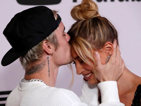 """Justin Bieber and his wife Hailey Baldwin pose at the premiere for the documentary television series """"Justin Bieber: Seasons"""" in Los Angeles, Jan. 27, 2020."""