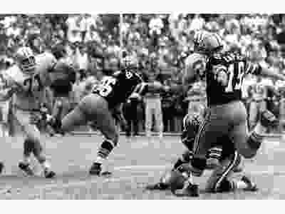 April 4: Former NFL placekicker Tom Demspey died from health complications after contracting COVID-19 at a seniors' residence in New Orleans. Dempsey, who was born with no toes on his right foot or fingers on his right hand, joined the New Orleans Saints out of college in 1969. On Nov. 8, 1970, the Milwaukee, Wis.-born Dempsey kicked a 63-yard field goal (seen above), which won the game against the Detroit Lions and set an NFL record. While it was matched three times, he held onto the record for longest field goal until Dec. 8, 2013, when Denver Broncos' Matt Prater kicked a 64-yard one against the Tennessee Titans. Dempsey also played for the Philadelphia Eagles, Los Angeles Rams, the Houston Oilers and Buffalo Bills before his retirement in 1979. He was 73.