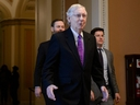 Senate Majority Leader Mitch McConnell walks to his office after delivering remarks in the Senate chamber at the U.S. Capitol in Washington, D.C., on Tuesday, Feb. 4, 2020.