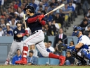 Mookie Betts of the Boston Red Sox hits a home run against the Los Angeles Dodgers in Game 5 of the World Series at Dodger Stadium on October 28, 2018 in Los Angeles. (Harry How/Getty Images)