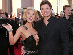 """In this Nov. 14, 2004, file photo, Jessica Simpson and Nick Lachey arrive at the 32nd Annual """"American Music Awards"""" at the Shrine Auditorium in Los Angeles."""