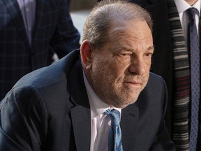 In this Feb. 24, 2020, photo, Harvey Weinstein arrives at New York Criminal Court for another day of jury deliberations in his sexual assault trial in the Manhattan borough of New York City.
