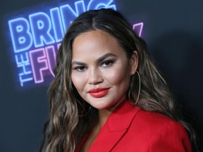"""Chrissy Teigen attends the premiere of NBC's """"Bring The Funny"""" at Rockwell Table & Stage, June 26, 2019 in Los Angeles."""