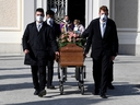 Pallbearers wearing protective masks carry the coffin of a woman who died from coronavirus disease (COVID-19) at her funeral, as Italy struggles to contain the spread of coronavirus disease (COVID-19), in Seriate, Italy March 28, 2020. (REUTERS/Flavio Lo Scalzo)