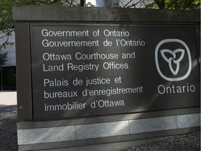 A file photo of a sign at the Ottawa courthouse on Elgin Street.