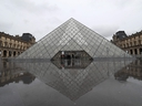 A view of the deserted court yard outside the closed Pyramid, the main entrance to the Louvre museum which was once a royal residence, located in central in Paris on March 2, 2020. (LUDOVIC MARIN/AFP via Getty Images)