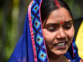 Punita Devi, wife of Akshay Thakur, one of the four men convicted for the gang-rape and murder case of a student, reacts as she speaks to media representatives, outside the Patiala House Court in New Delhi on March 19, 2020. (PRAKASH SINGH/AFP via Getty Images)