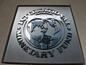 In this file photo taken on June 30, 2015 a logo is seen outside the headquarters of the International Monetary Fund in Washington, DC.