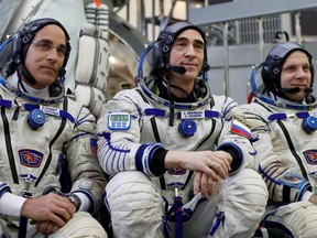 Crew members of the International Space Station Chris Cassidy (left) of NASA, Anatoly Ivanishin (centre) and Ivan Vagner (right) of the Russian space agency Roscosmos, pose for a photo as they attend the final qualification training for the upcoming space mission in Star City near Moscow, Russia, March 12, 2020.
