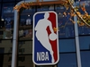 FILE PHOTO: An NBA logo is seen on the facade of its flagship store at the Wangfujing shopping street in Beijing, China October 8, 2019. REUTERS/Tingshu Wang/File Photo ORG XMIT: FW1