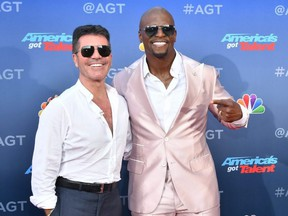"Simon Cowell and Terry Crews attend the ""America's Got Talent"" Season 15 kickoff at Pasadena Civic Auditorium in Pasadena, Calif., on March 4, 2020."