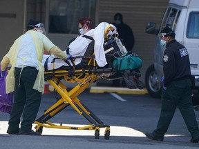 A patient is wheeled to an ambulance during the outbreak of Coronavirus disease (COVID-19), in the Manhattan borough of New York City, New York, U.S., March 26, 2020.