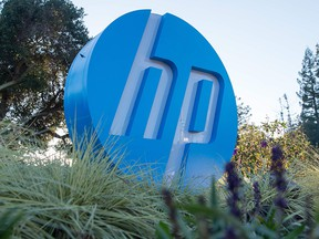 In this file photo taken on Nov. 4, 2016, the HP logo is seen on a sign at Hewlett Packard's headquarters in Palo Alto, Calif.
