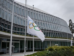 The headquarters of the International Olympic Committee is seen in Lausanne, Switzerland, Sunday, March 22, 2020, as doubts increase over whether Tokyo can safely host the Summer Games amid the spread of COVID-19.
