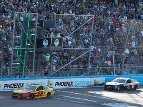 Joey Logano, driver of the #22 Shell Pennzoil Ford, crosses the finish line to win the NASCAR Cup Series FanShield 500 at Phoenix Raceway in Avondale, Ariz., on March 8, 2020.