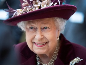 Britain's Queen Elizabeth II talks with MI5 officers during a visit to the headquarters of MI5 at Thames House in London February 25, 2020. (Victoria Jones/PA Wire/Pool via REUTERS/File Photo)