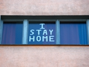 A sign is seen at a residential building in Berlin March 25, 2020, as the spread of the coronavirus continues. (REUTERS/Fabrizio Bensch)
