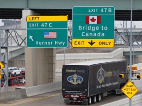 A commercial truck heads for the Ambassador Bridge , during the COVID-19 coronavirus outbreak, at the international border crossing, which connects with Windsor, Ont., in Detroit, Wednesday, March 18, 2020.