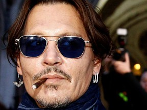 Actor Johnny Depp leaves the High Court in London, Britain, Feb. 26, 2020.