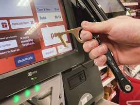 The CleanKey brass device was created during the pandemic to allow people to use the device rather than their hands at touchscreen grocery checkouts or bank machines.