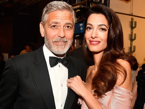 George Clooney (L) and Amal Clooney attend the American Film Institute's 46th Life Achievement Award Gala Tribute to George Clooney at Dolby Theatre  on June 7, 2018, in Hollywood, Calif.