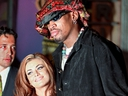 Former Chicago Bulls star Dennis Rodman and his wife Carmen Electra pose for photographers 22 February during a press conference in Beverly Hills. Rodman connfirmed that he will sign a deal to play for the Los Angeles Lakers.