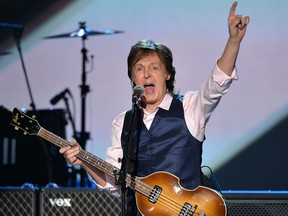"""Paul McCartney performs onstage during """"The Night That Changed America: A GRAMMY Salute To The Beatles"""" at the Los Angeles Convention Center on Jan. 27, 2014, in Los Angeles."""