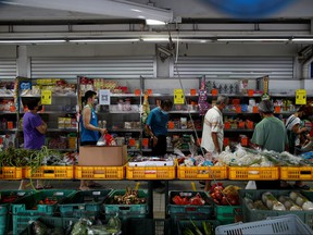 People queue up outside a grocery shop, amid the coronavirus disease (COVID-19) outbreak in Singapore May 12, 2020.