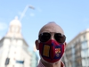 A man wearing a protective mask with colours of the Catalunya flag and Barcelona football club crest poses for a picture, as some Spanish provinces are allowed to ease lockdown restrictions during phase one, amid the coronavirus disease (COVID-19) outbreak in Barcelona, Spain, May 25, 2020.