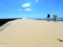 People walk on Europe's tallest sand dune called
