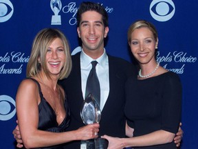 Actors Jennifer Aniston (left) David Schwimmer and Lisa Kudrow hold their award as Favorite Television Comedy Series at the 27th annual People's Choice Awards in Pasadena January 7, 2001.