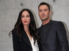 Megan Fox and Brian Austin Green pose as they arrive for the Emporio Armani spring-summer 2011 ready-to-wear collection on Sept. 25, 2010 during the Women's fashion week in Milan.