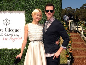 Actress Jaime King (R) and Producer/Director Kyle Newman arrive at the Veuve Clicquot Polo Classic Los Angeles at Will Rogers State Historic Park on October 9, 2011 in Los Angeles, California.