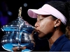 FILE PHOTO: Tennis - Australian Open - Women's Singles Final - Melbourne Park, Melbourne, Australia, January 26, 2019. Japan's Naomi Osaka kisses her trophy after winning her match against Czech Republic's Petra Kvitova. REUTERS/Kim Kyung-Hoon/File Photo ORG XMIT: FW1