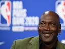 Former NBA star and owner of the Charlotte Hornets Michael Jordan looks on as he addresses a press conference at The AccorHotels Arena in Paris on January 24, 2020.