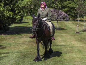 Britain's Queen Elizabeth II rides Balmoral Fern in Windsor Home Park over the weekend of May 30-31, 2020.