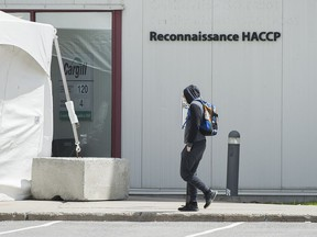 A man walks into a Cargill meat processing plant in Chambly, Que., south of Montreal, Sunday, May 10, 2020.