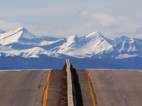 Alberta Provincial Highway 23 stretches toward High River, south of Calgary with the Rocky Mountains in the background on May 3, 2017.