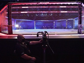 A member of the UFC staff looks on during UFC Fight Night at VyStar Veterans Memorial Arena on May 16, 2020 in Jacksonville, Florida.