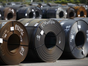 Steel coils lay in a yard at ArcelorMittal Dofasco steel plant on June 4, 2018 in Hamilton, Ont.