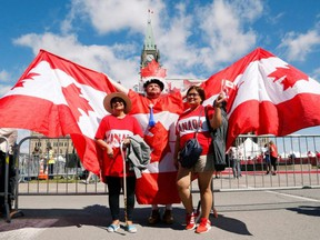 Andrew Larche poses for photos during Canada Day festivities on Parliament Hill in Ottawa, July 1, 2019.