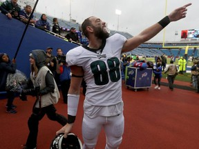 Eagles tight end Dallas Goedert signals to a fan after an NFL game against the Bills at New Era Field in Orchard Park, N.Y., on Oct. 27, 2019.