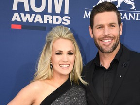 Carrie Underwood and husband Mike Fisher arrive for the 54th Academy of Country Music Awards on April 7, 2019, at the MGM Grand Garden Arena in Las Vegas, Nevada.