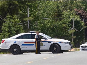 Members of the RCMP control the scene where a man was shot on Friday night, near Miramichi, N.B. on Saturday, June 13, 2020.
