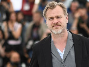 In this file photo taken on May 12, 2018 British director Christopher Nolan poses on May 12, 2018 during a photocall in Cannes.