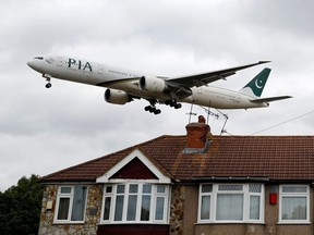 A Pakistan International Airlines Boeing 777 lands at Heathrow airport in London on June 8, 2020.