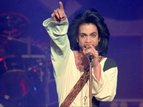 In this file photo taken on June 16, 1990 musician Prince performs on stage during his concert at the Parc des Princes stadium in Paris.