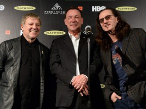 Alex Lifeson, Neil Peart, and Geddy Lee pose in the press room at the 28th Annual Rock and Roll Hall of Fame Induction Ceremony at Nokia Theatre L.A. Live on April 18, 2013 in Los Angeles.