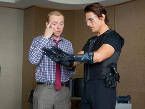 Simon Pegg (left) and Tom Cruise in a scene for Mission: Impossible -- Ghost Protocol.