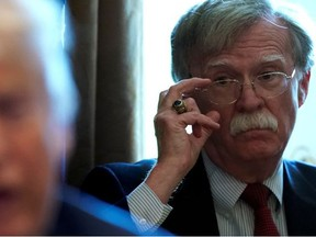 National Security Adviser John Bolton listens as U.S. President Donald Trump holds a Cabinet meeting at the White House in Washington, U.S., April 9, 2018.